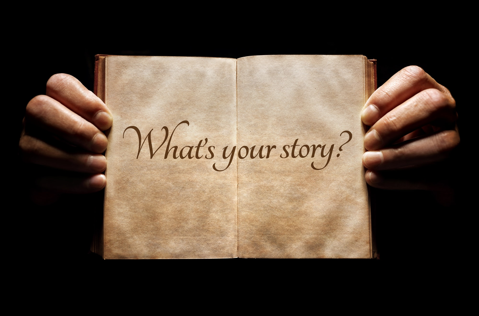 What's your story? hands holding an open book background message
