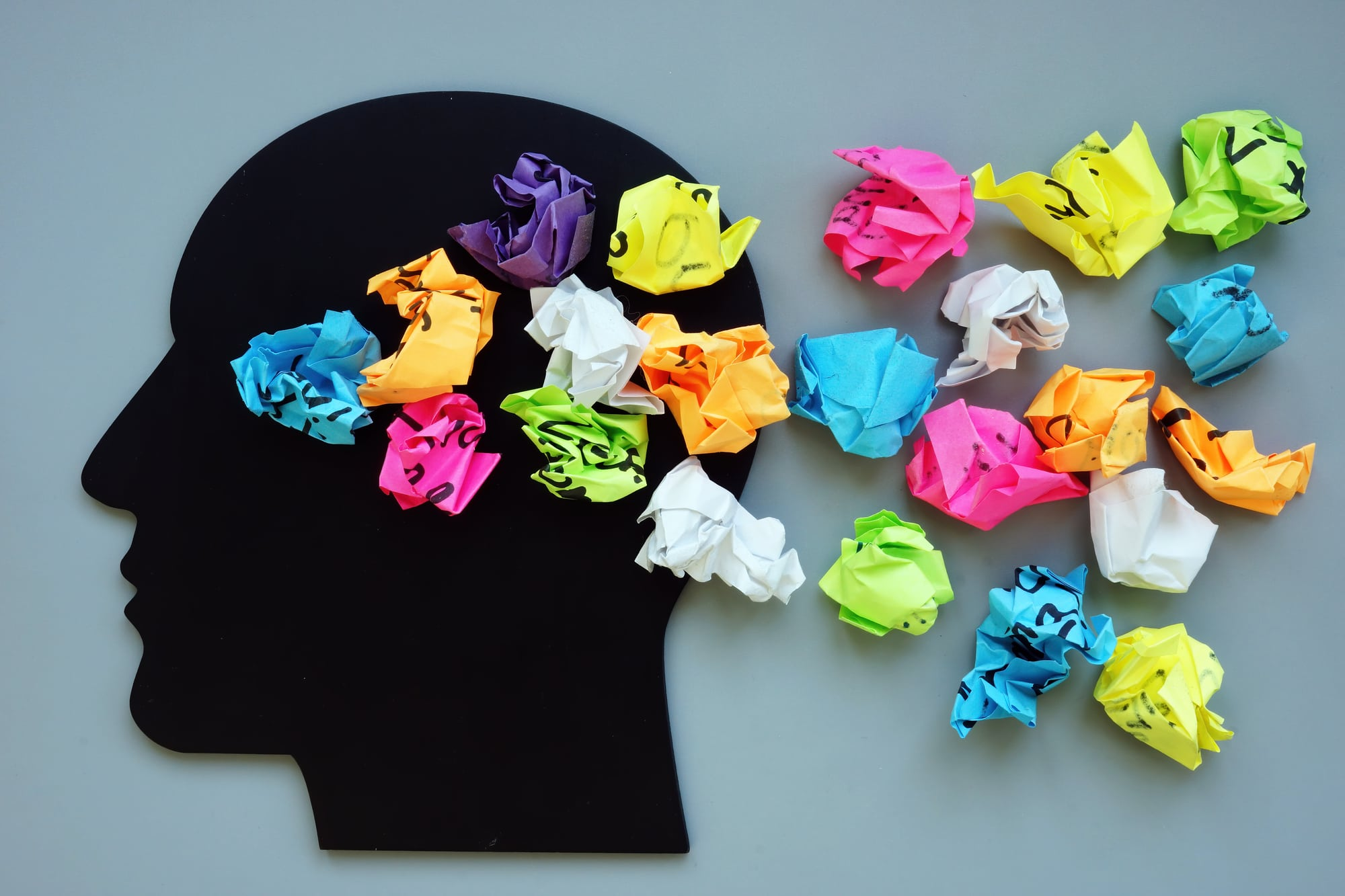 Thoughts, ideas and mindfulness concept. Head and paper balls.
