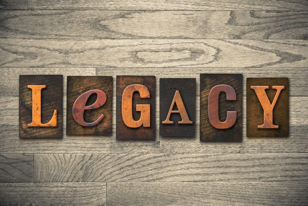 """The word """"LEGACY"""" written in wooden letterpress type."""