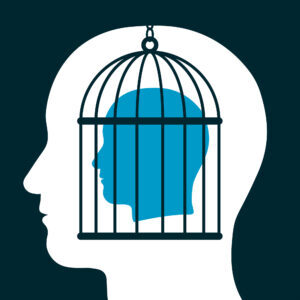 Conceptual illustration of a caged head emanating from a silhouetted head below showing a captive with lack of freedom of speech, mind, expression, personality and ideas